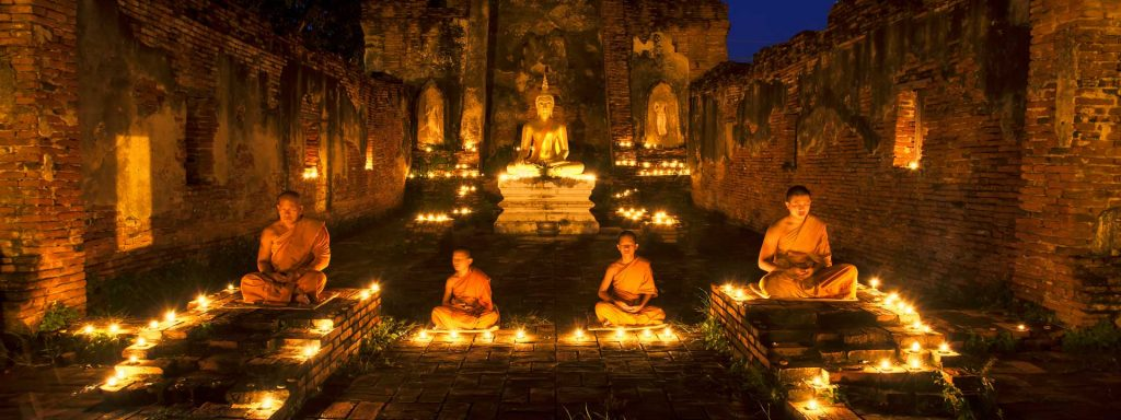 Asia monk vipassana for meditation at old temple of Thailand